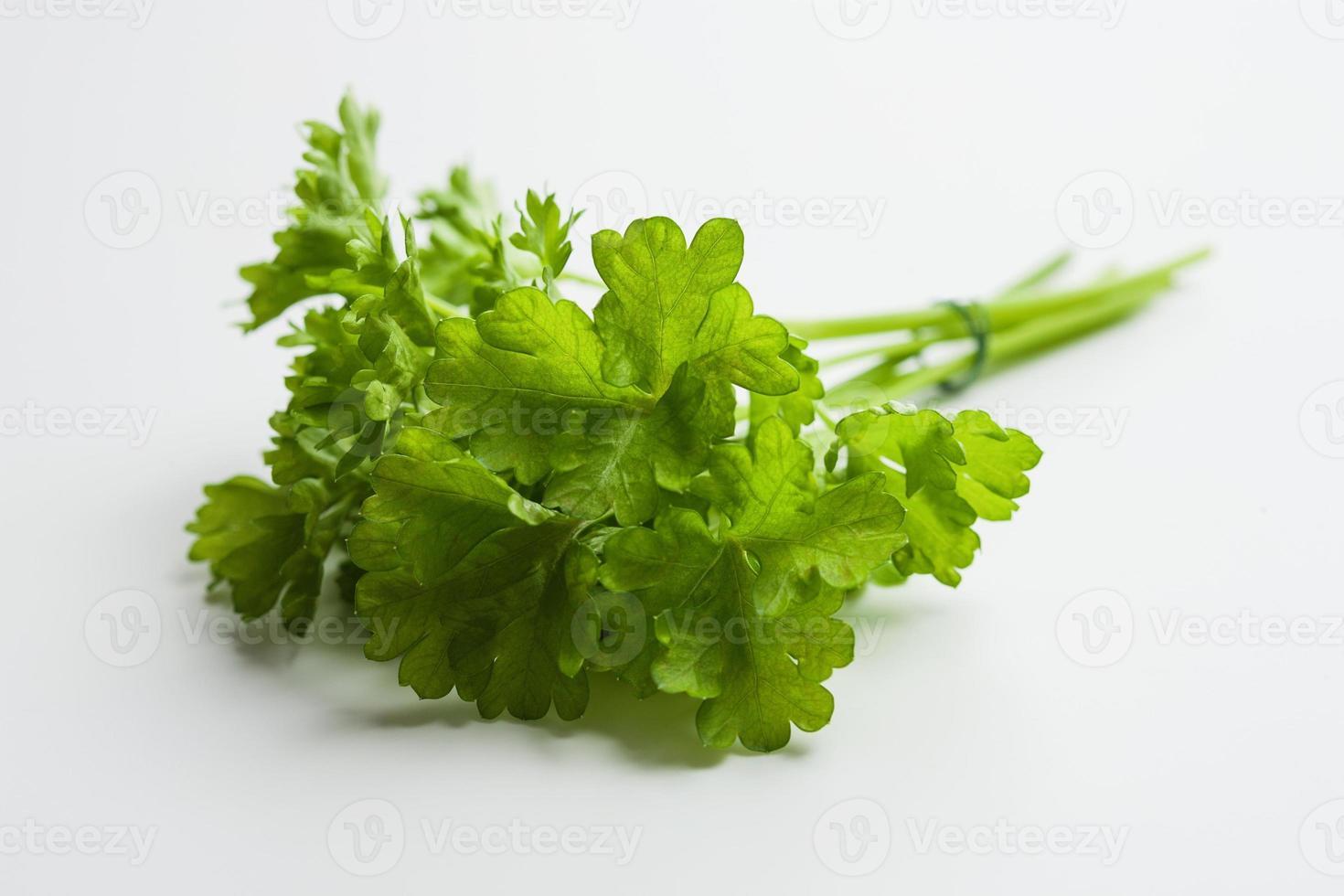 Fresh parsley on white photo