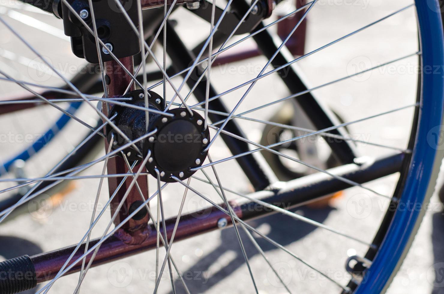 Spokes on the wheel of a wheelchair photo
