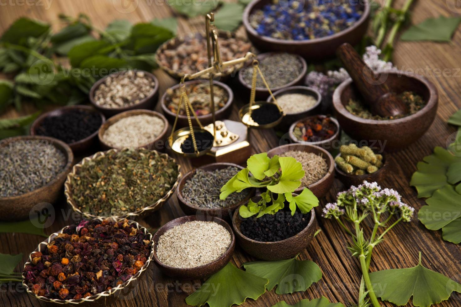 Natural remedy, mortar and herbs photo