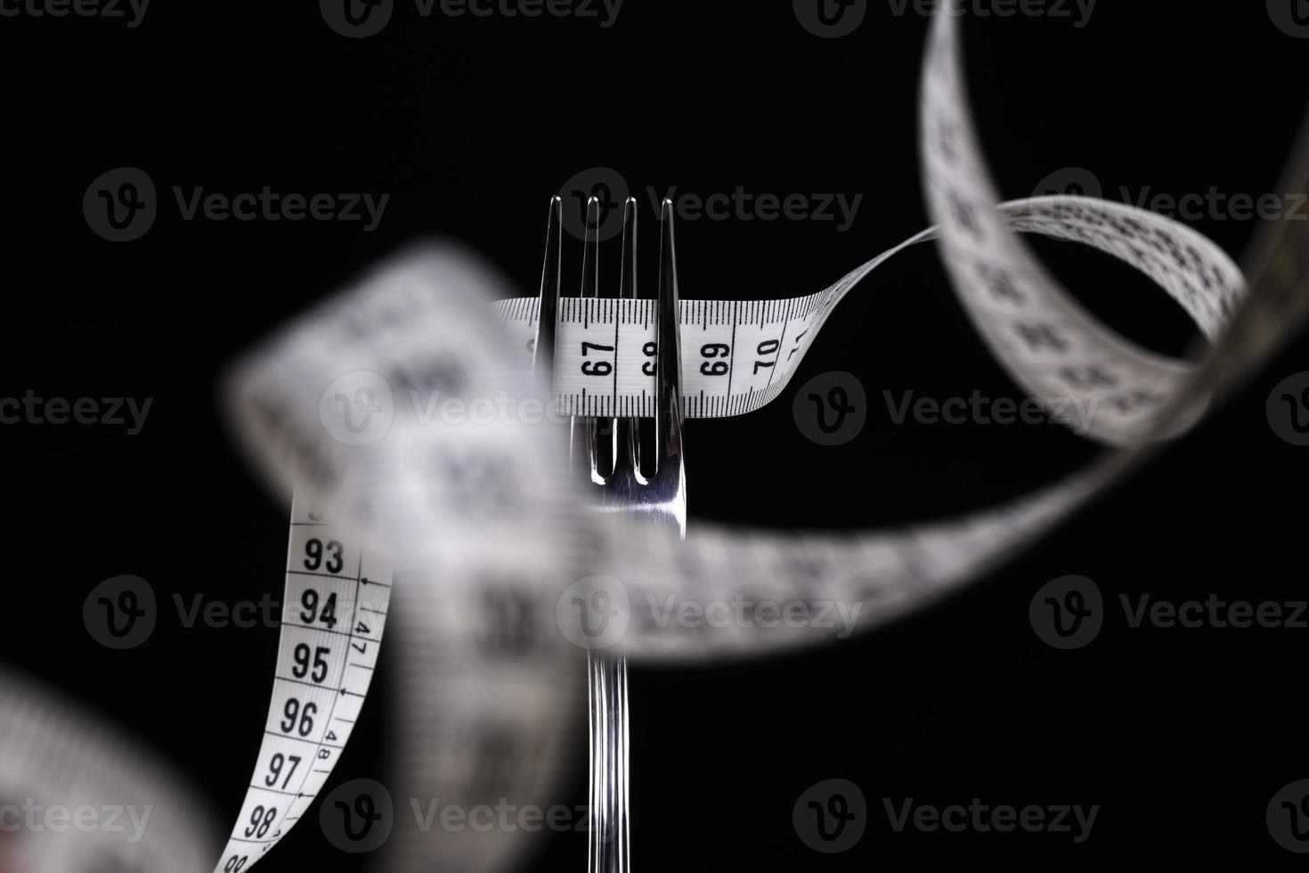 tenedor con cinta métrica foto