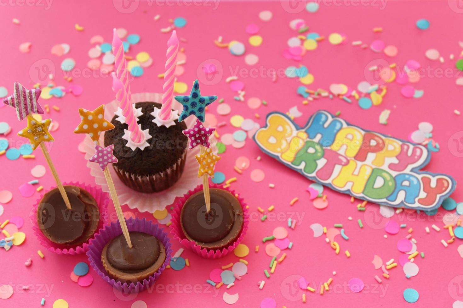 Cupcakes on pink confetti background - happy birthday card photo