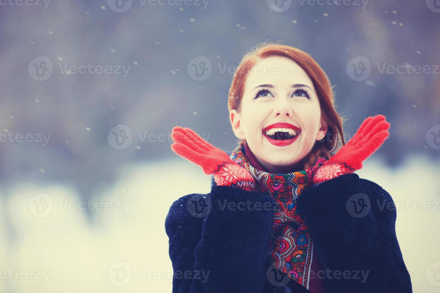 Beautiful redhead women with in winter park. photo