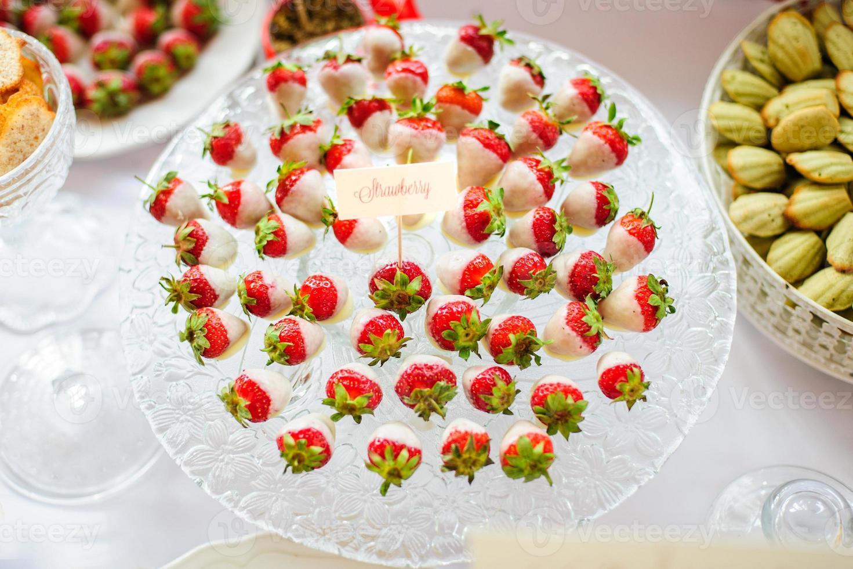 Fresh strawberries with white chocolate photo