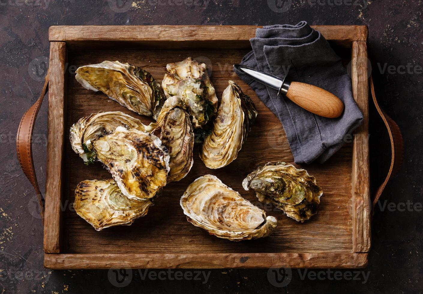 Oysters with oysters knife in box photo