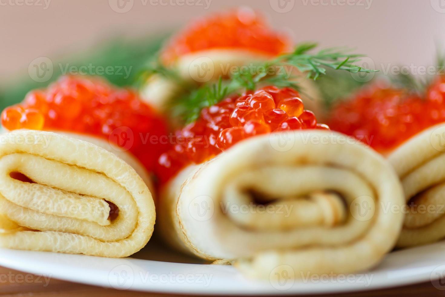 pancakes with red caviar photo