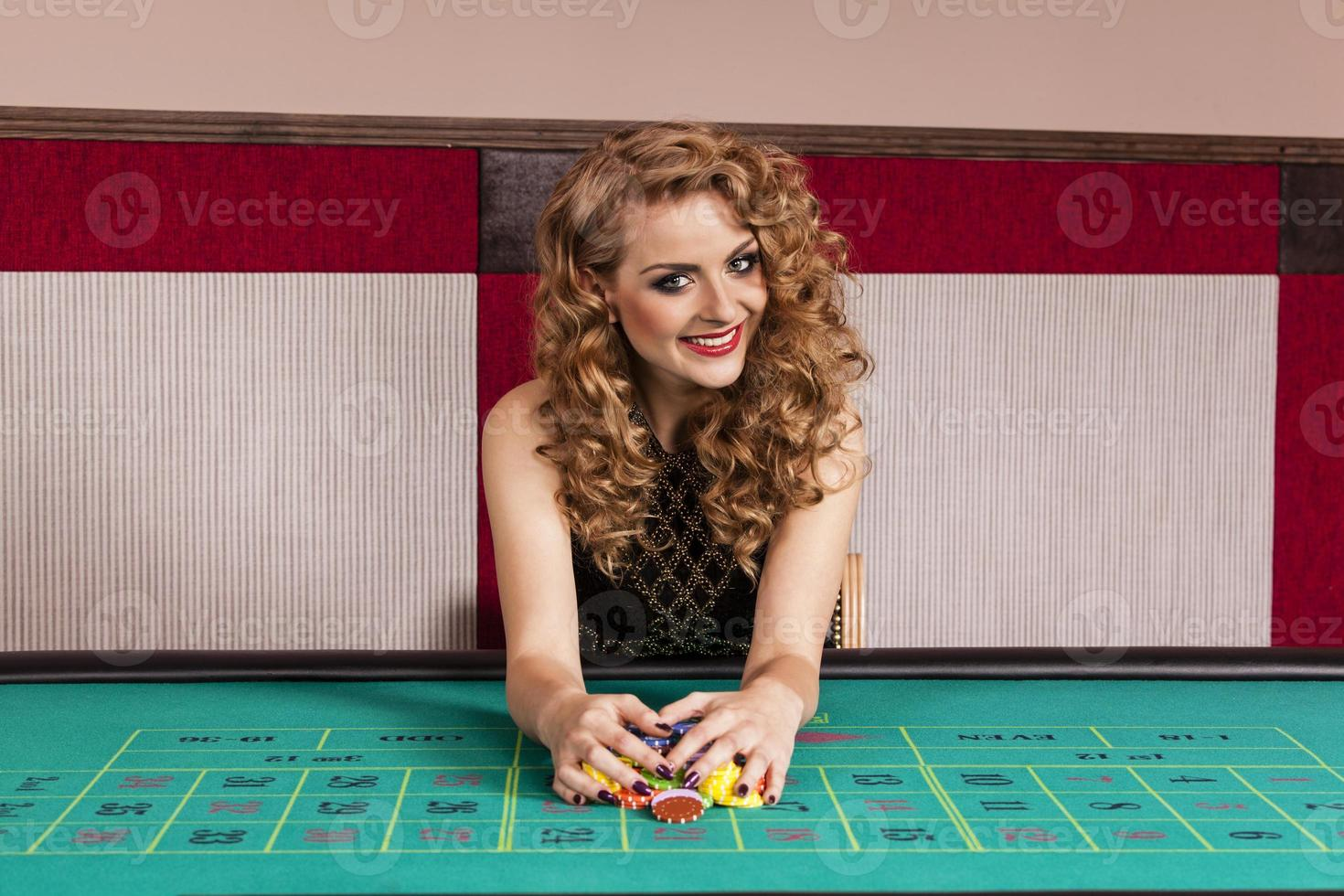 Blone elegant woman in casino photo