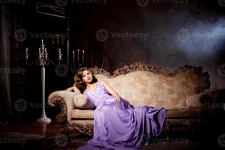 Luxury fashion stylish woman in the rich interior photo