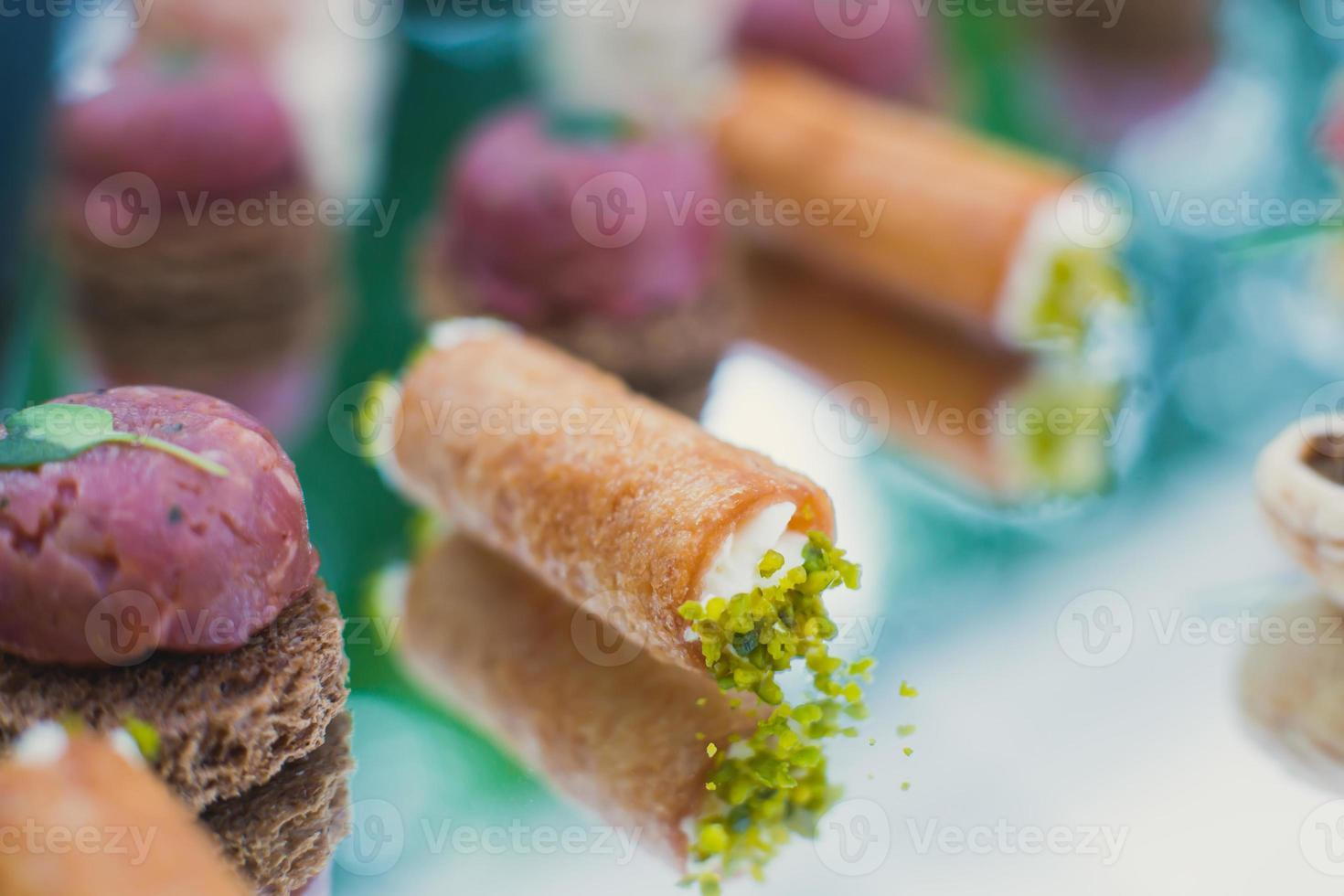 Beautifully decorated catering banquet table with different food snacks appetizers photo