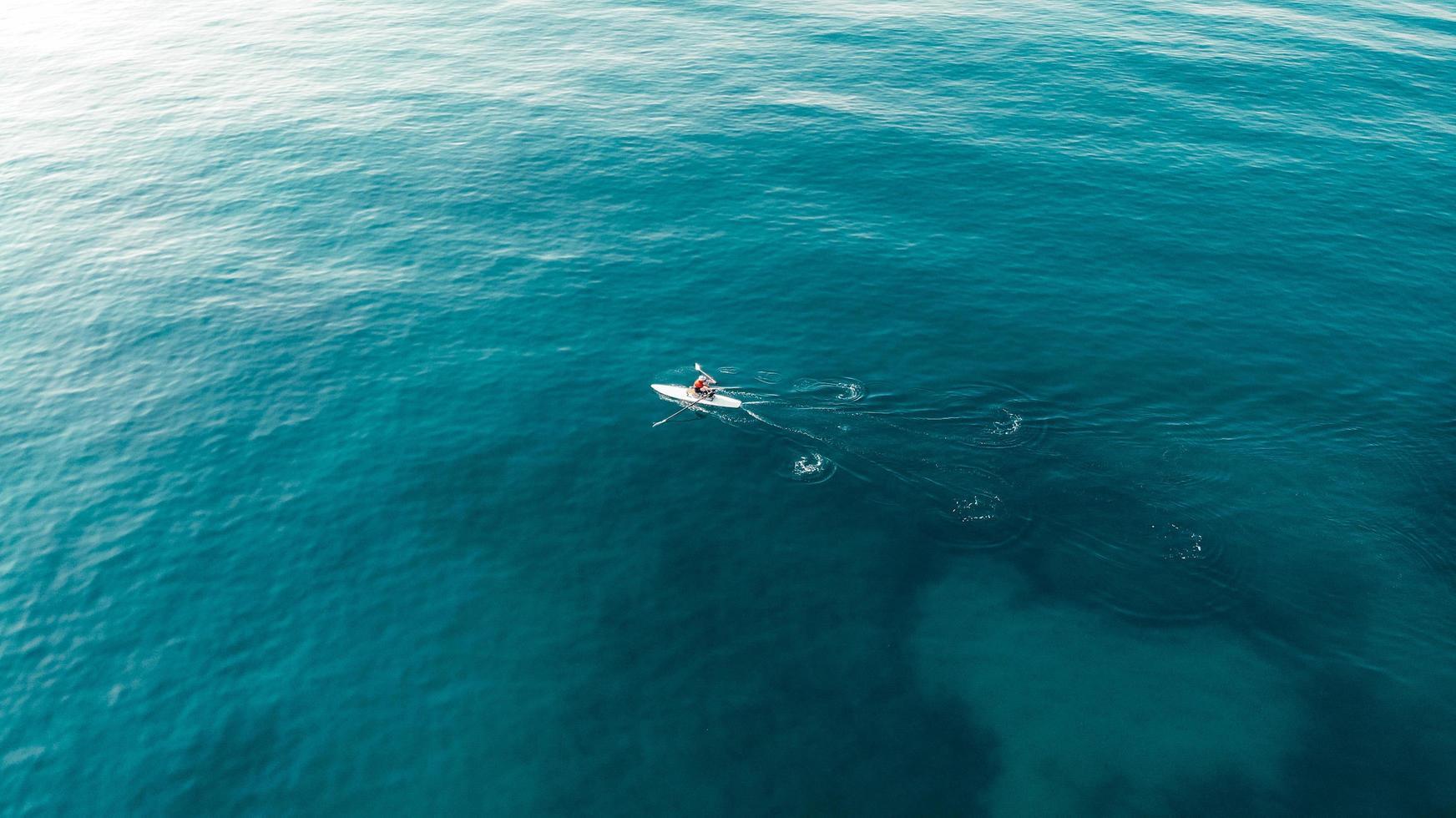 Man rowing on the sea photo
