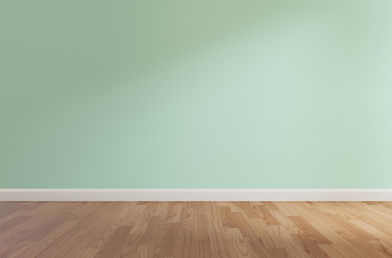 parete verde e pavimento in legno foto