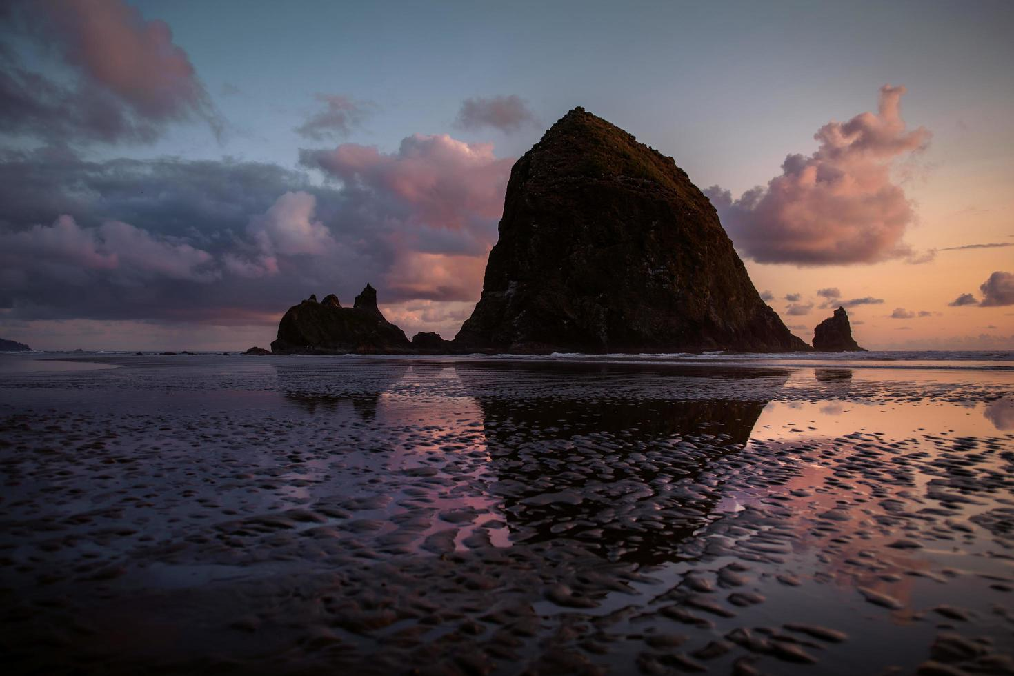 Haystack Rock in Oregon during golden hour photo