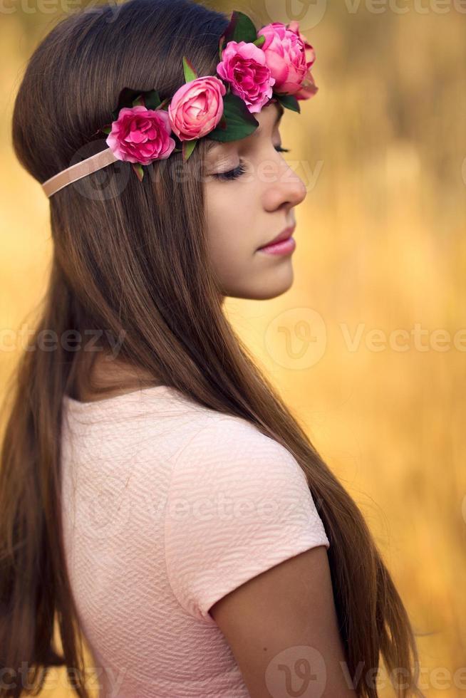 Beautiful girl with flower tiara photo