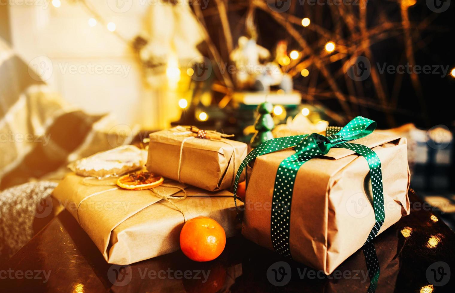 Gifts lie on wooden table photo