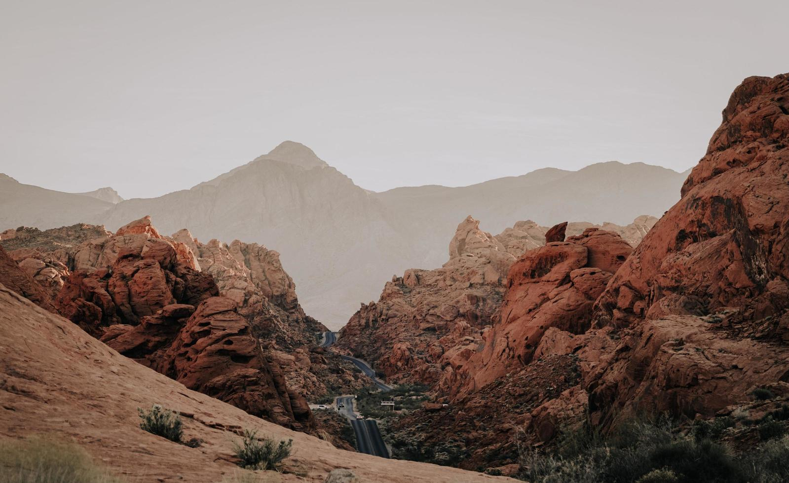 Brown rock formations in the desert photo