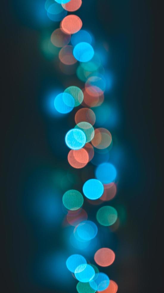 Vertical image of defocused lights photo