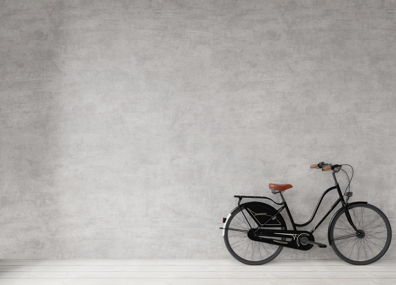 Bicycle against a concrete wall photo
