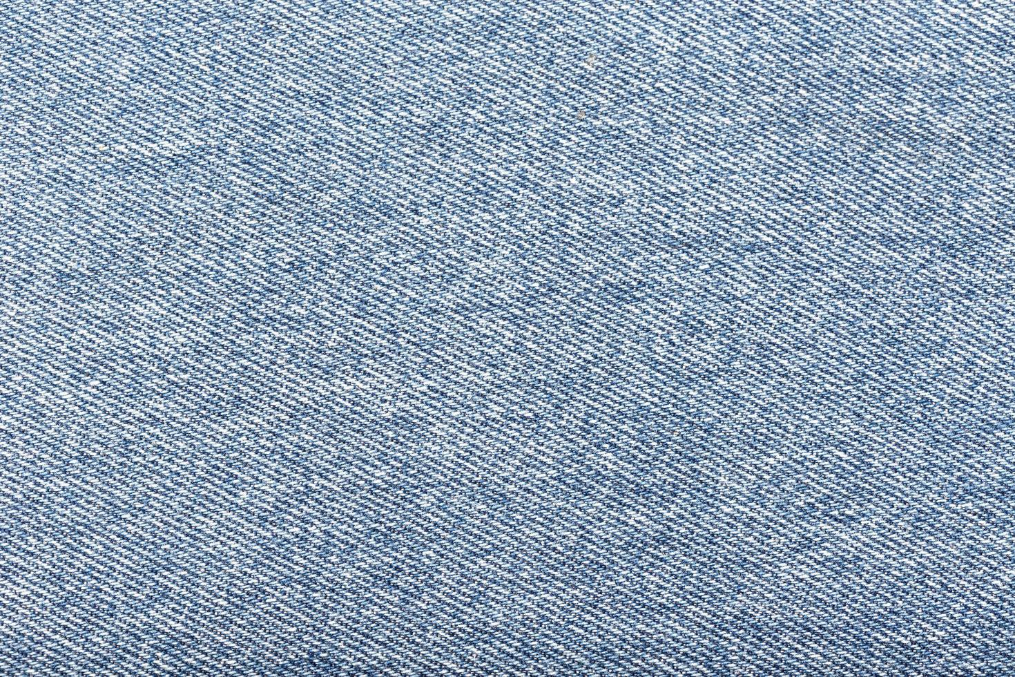 un primer plano de la tela de mezclilla azul claro foto