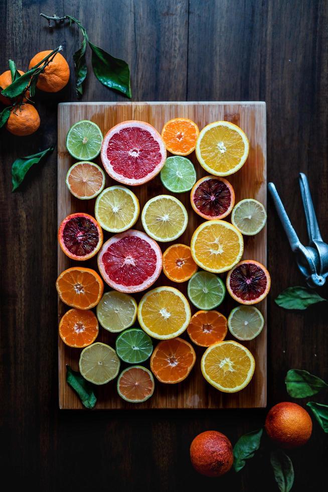 Citrus on cutting board photo