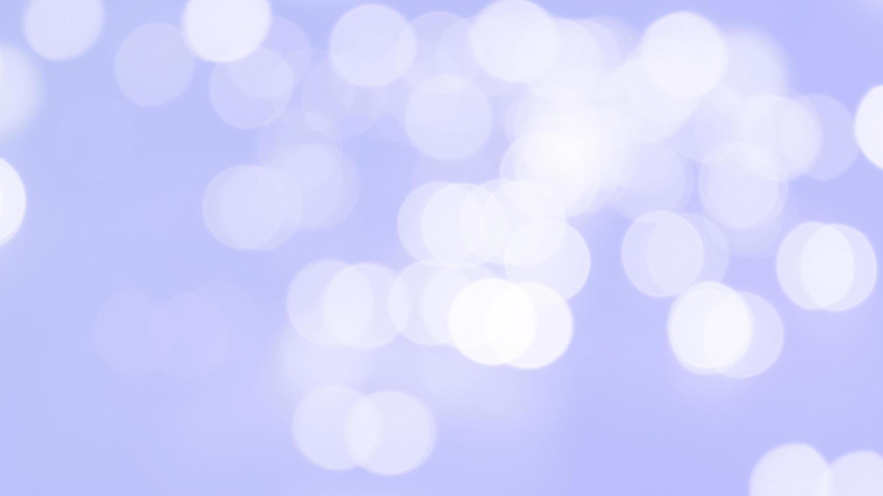 Bokeh lights on purple background photo