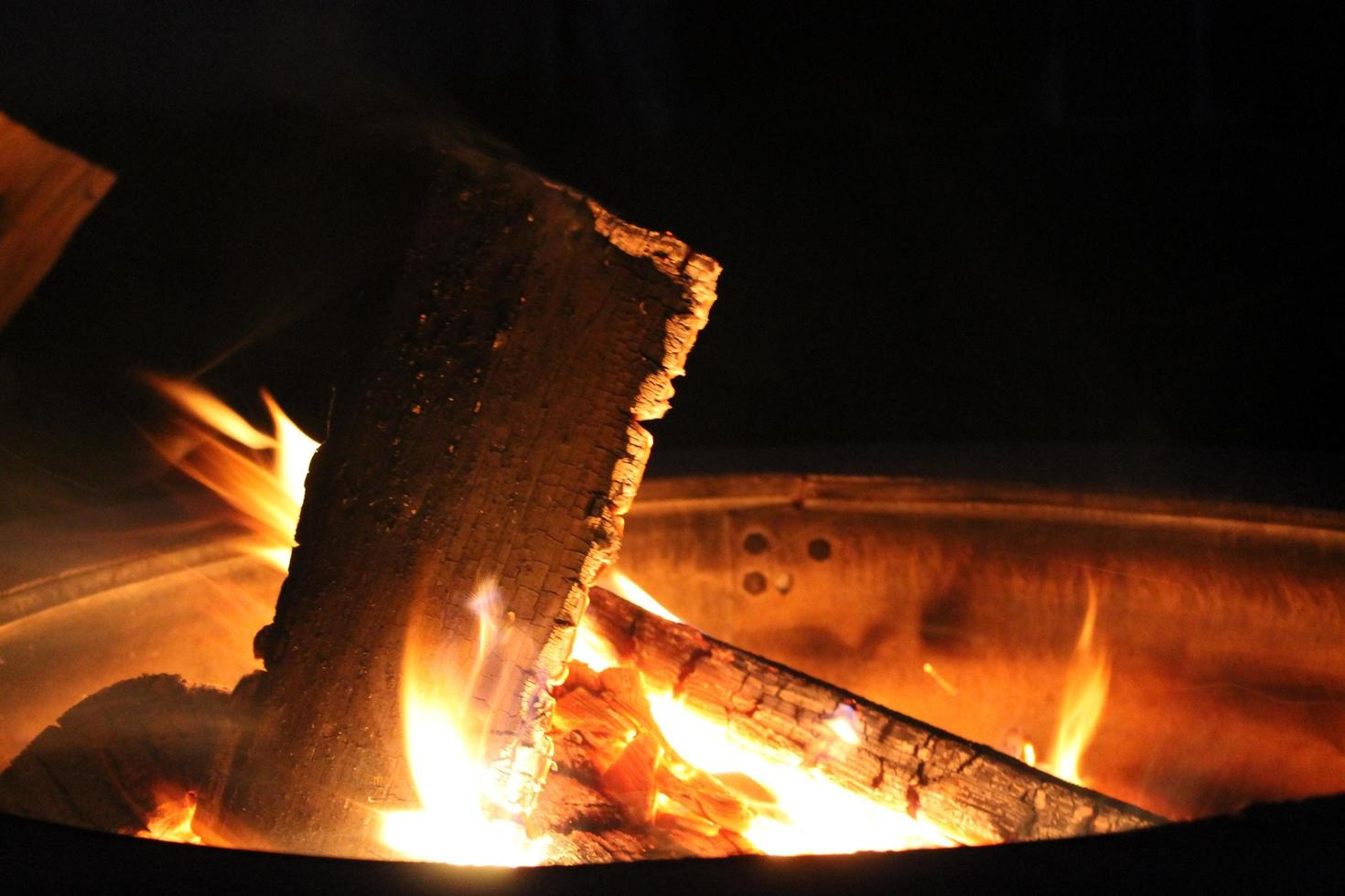 Burning wood in a fire pit photo