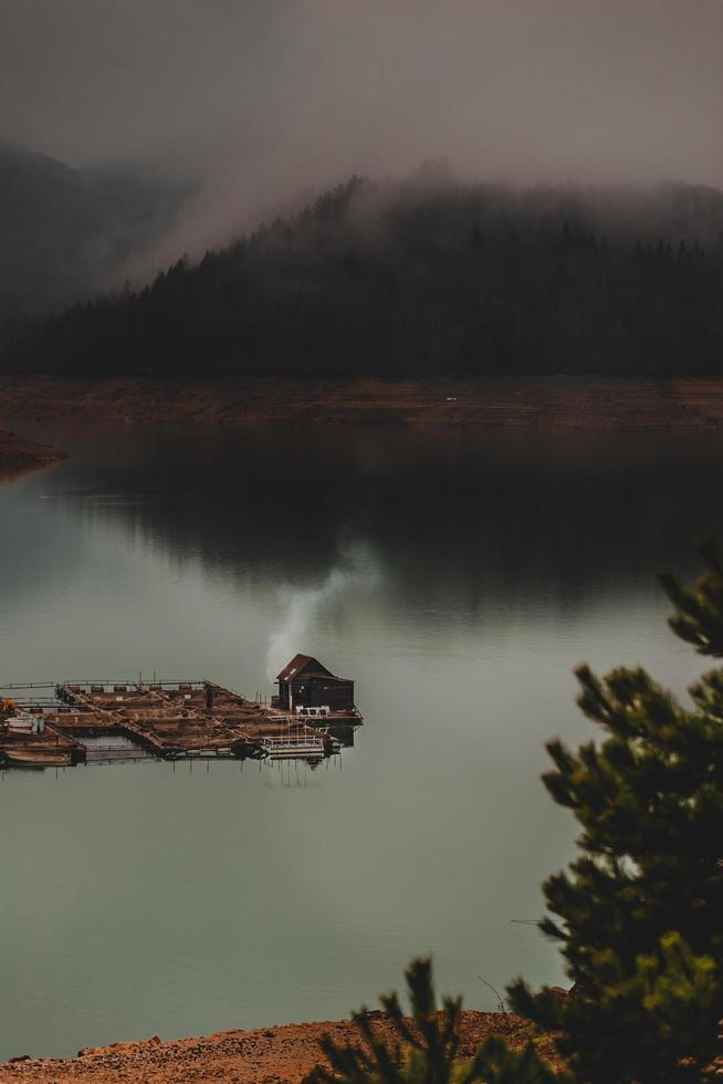 Moody lake in the rain photo