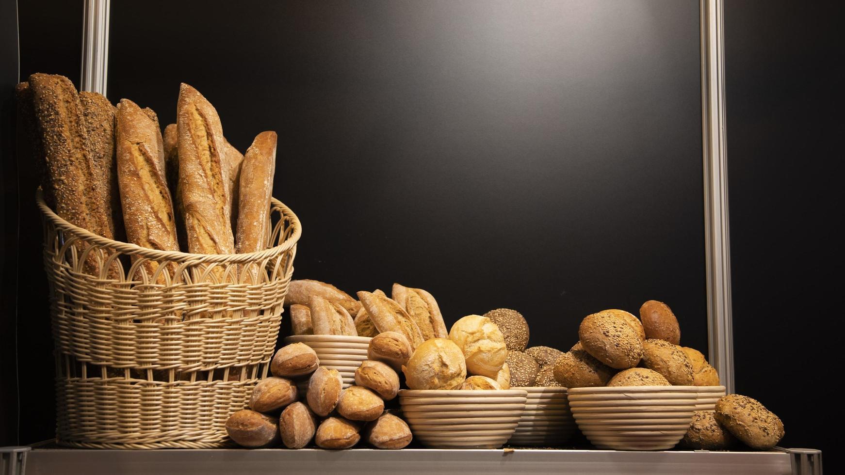 Baked bread on illuminated background photo