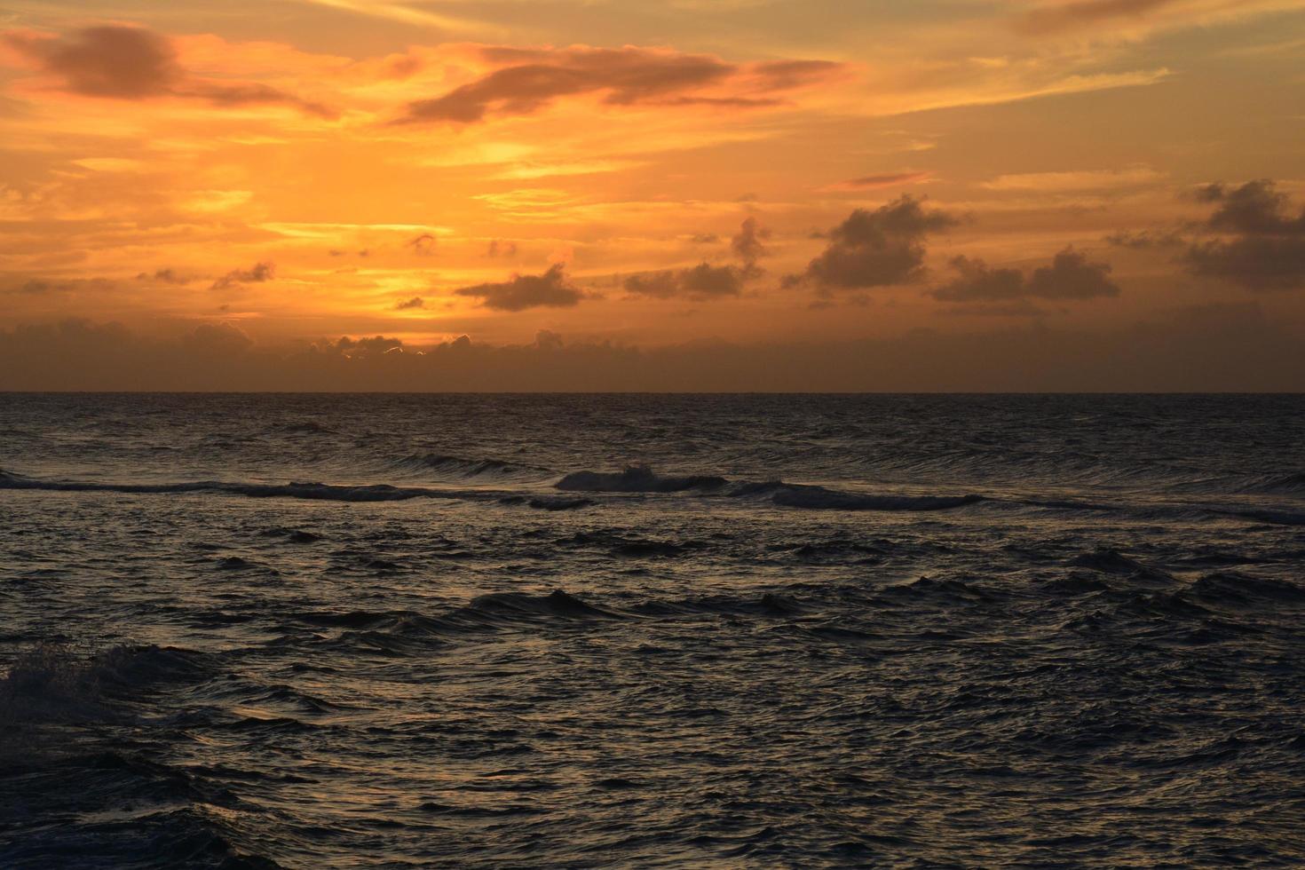 Orange sunset over the ocean photo