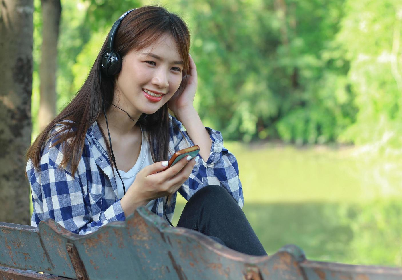 Woman listening to music on smartphone photo
