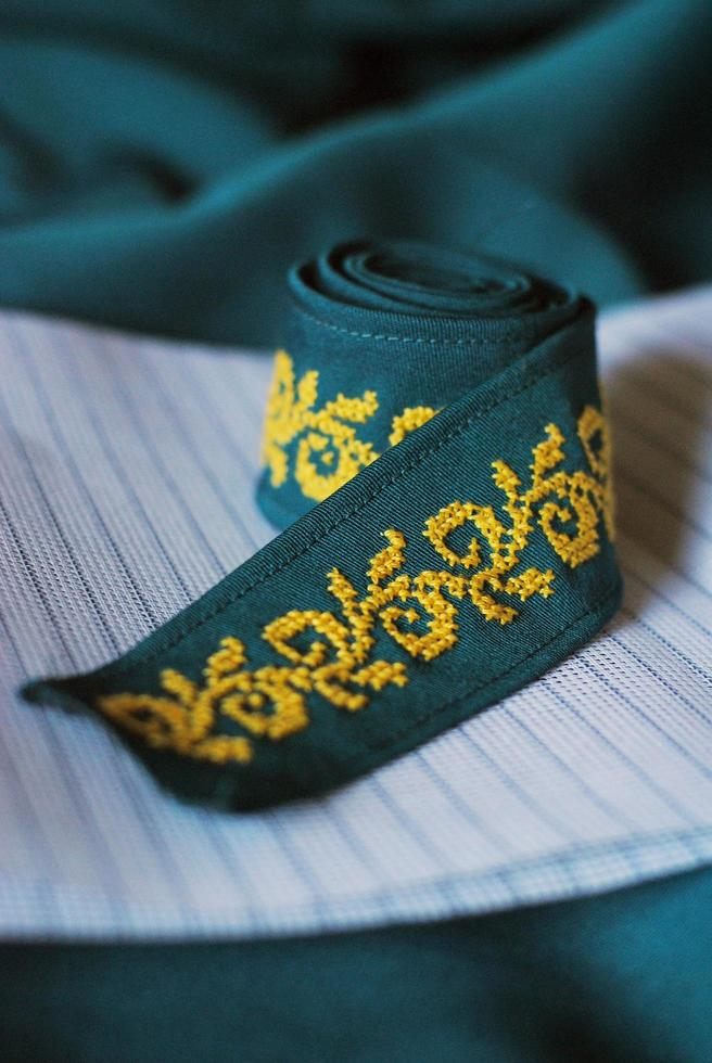 Cross stitch ethnic ornate on turquoise ribbon photo