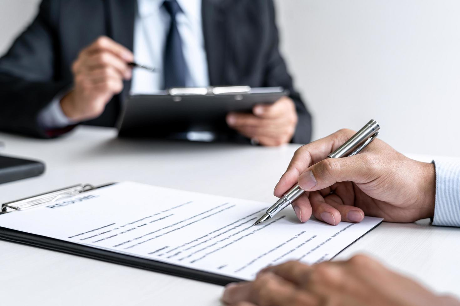 Close-up of a person signing a contract photo