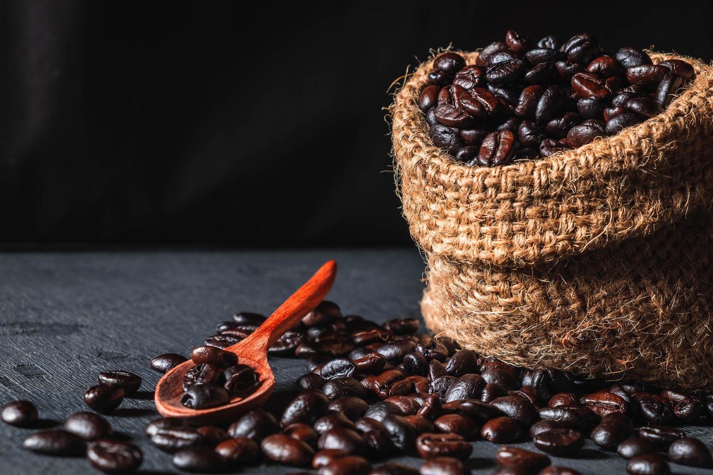 Raw coffee beans in a sack bag photo
