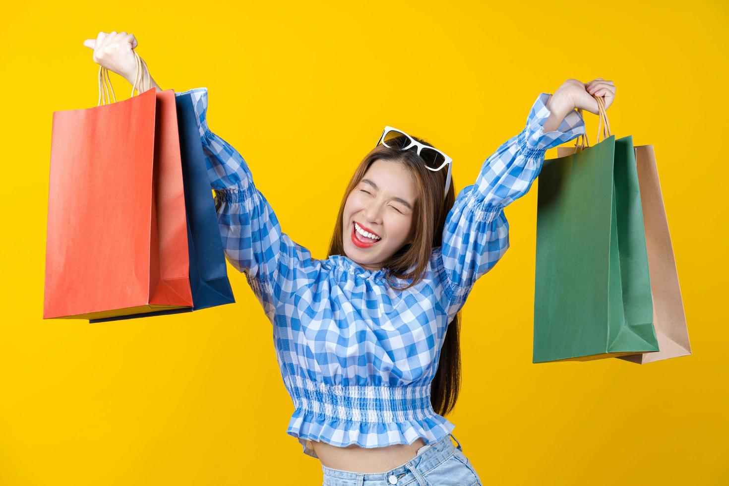 Young attractive woman carrying colorful shopping bags  photo