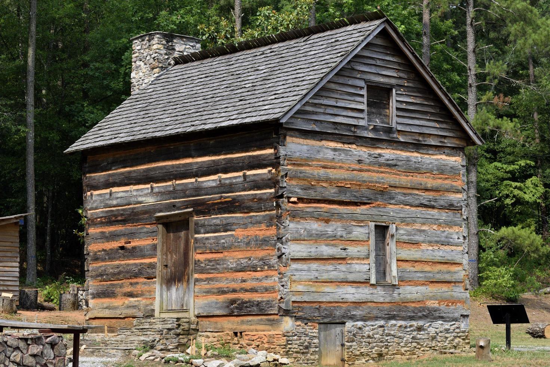 Old rustic log cabin photo