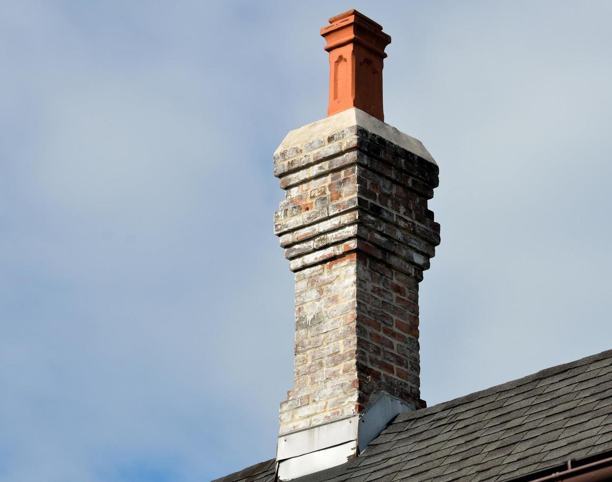 Vintage chimney on a roof photo