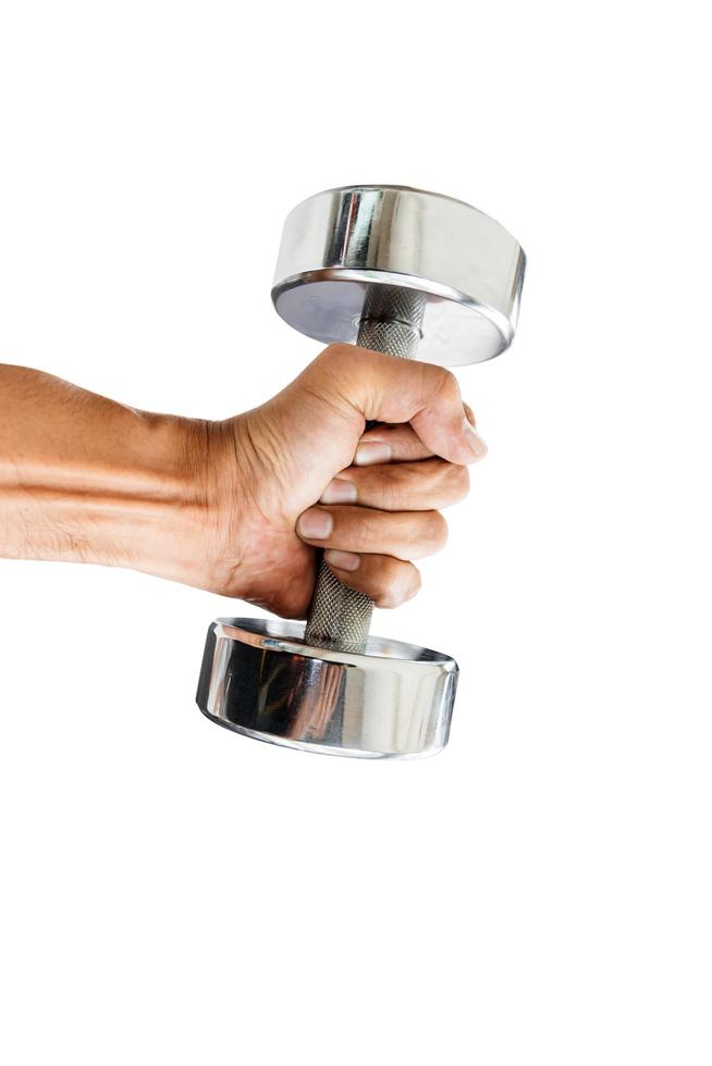 Close-up of a person holding a dumbbell photo