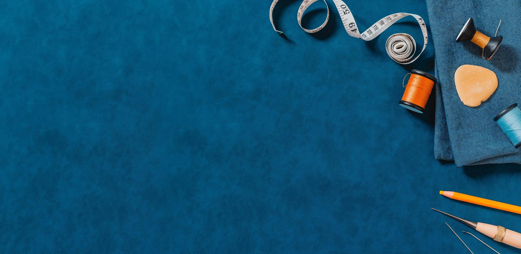 Blue textured background with sewing tools photo