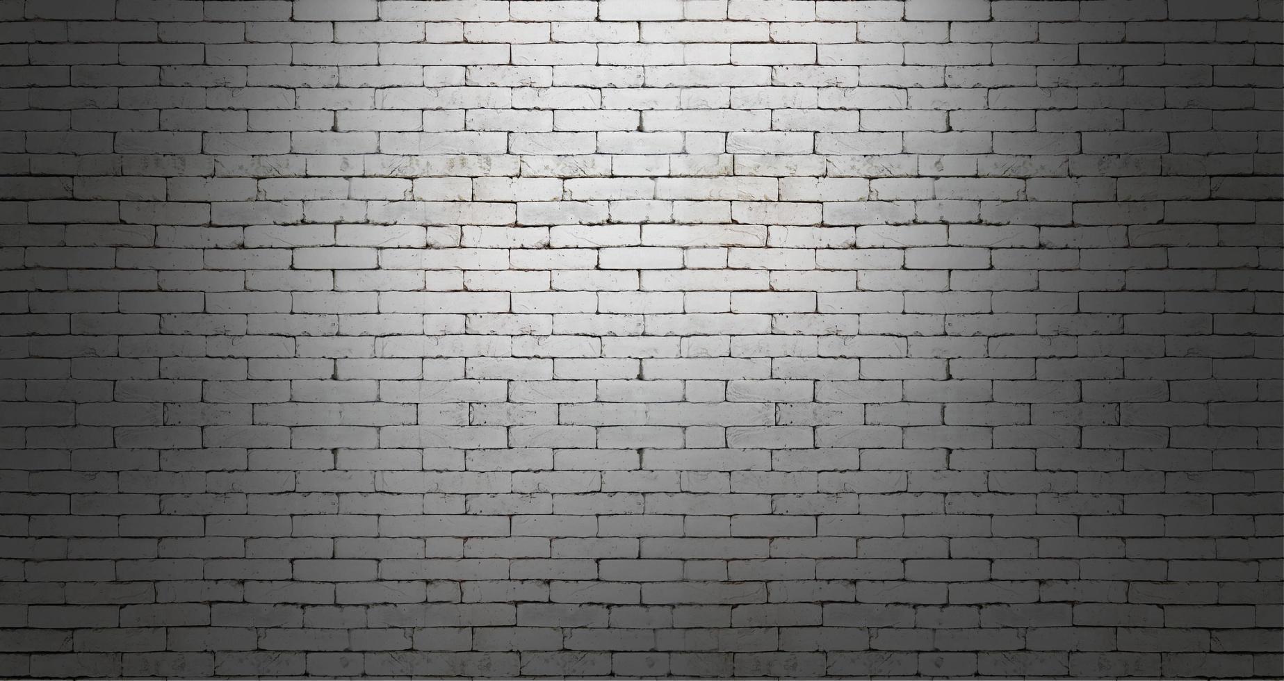 White brick wall on dark room background photo
