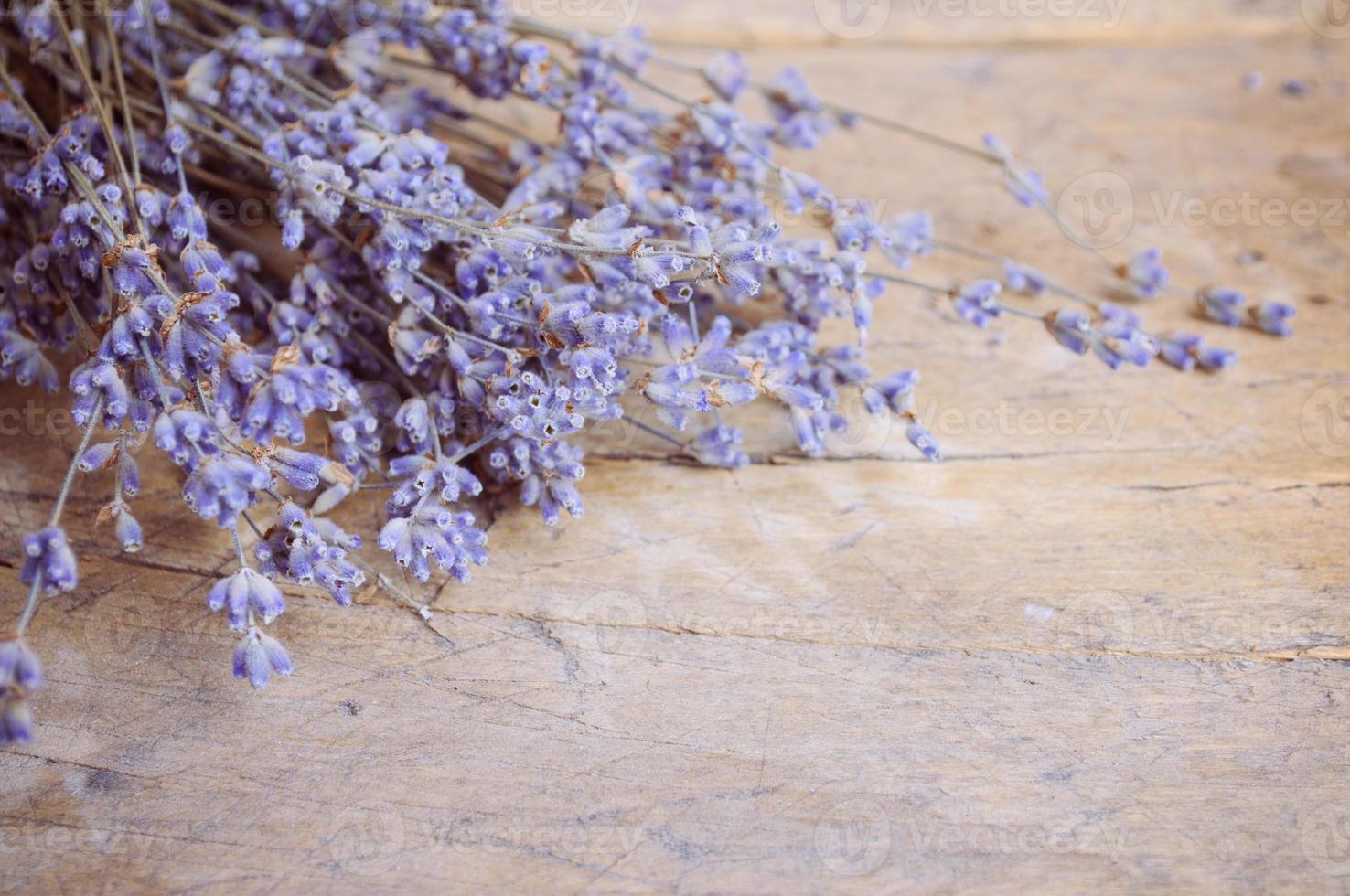 Lavender flower on wooden table photo