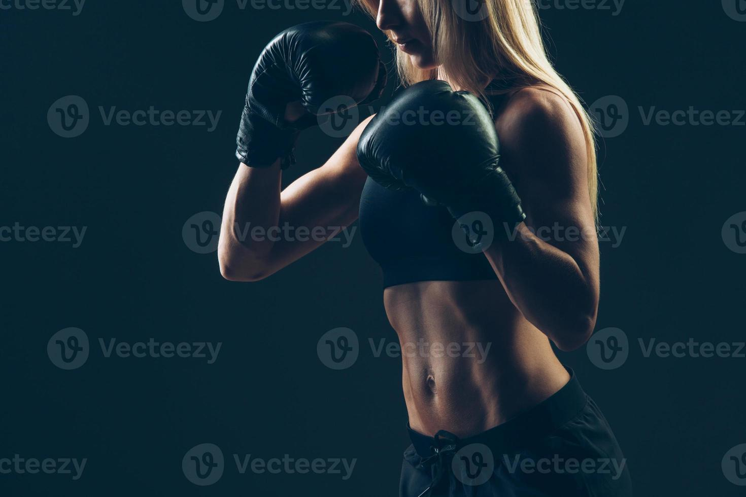 beautiful woman with the red boxing gloves,black background photo