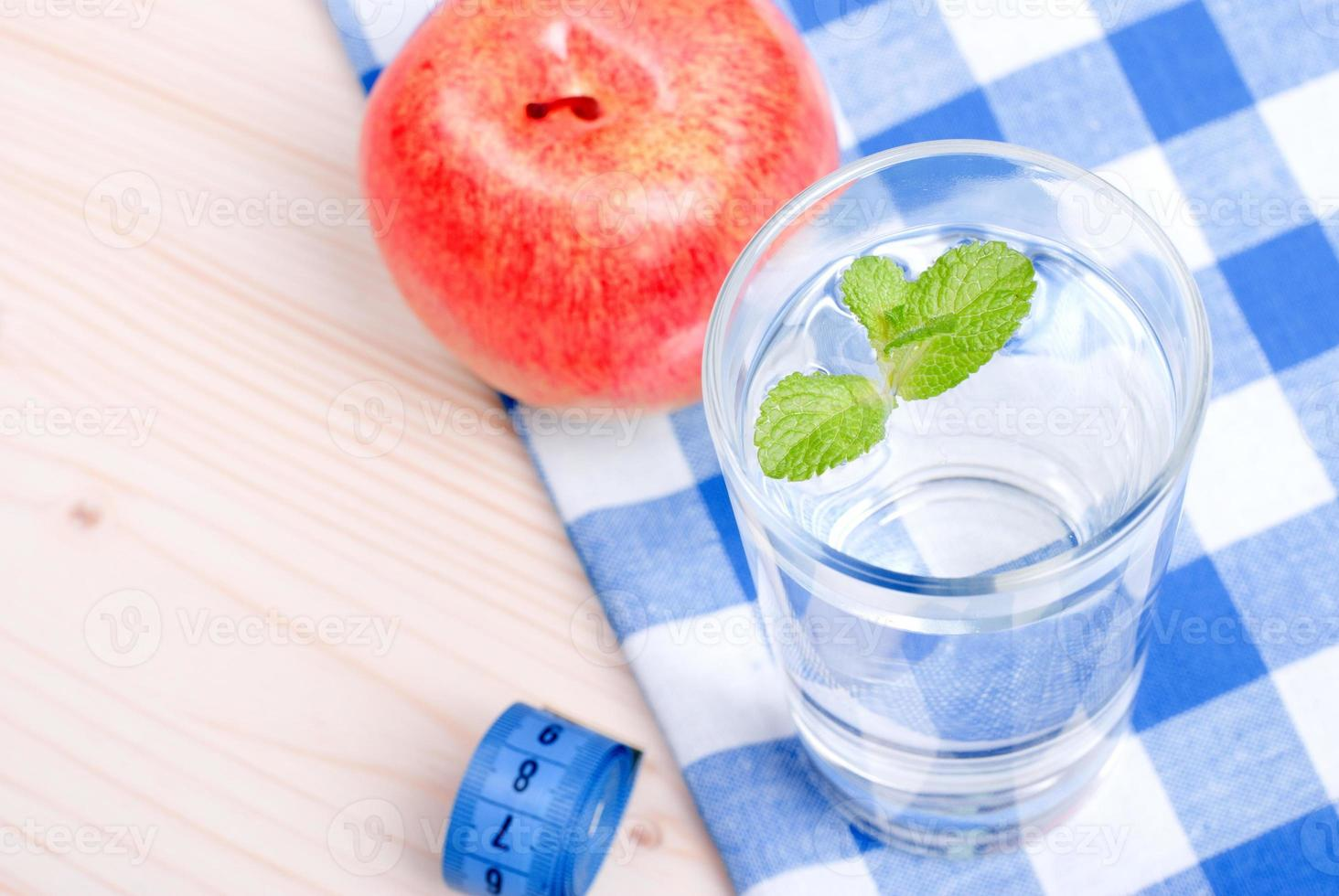 glass of clean water with mint on a table  centimeter photo