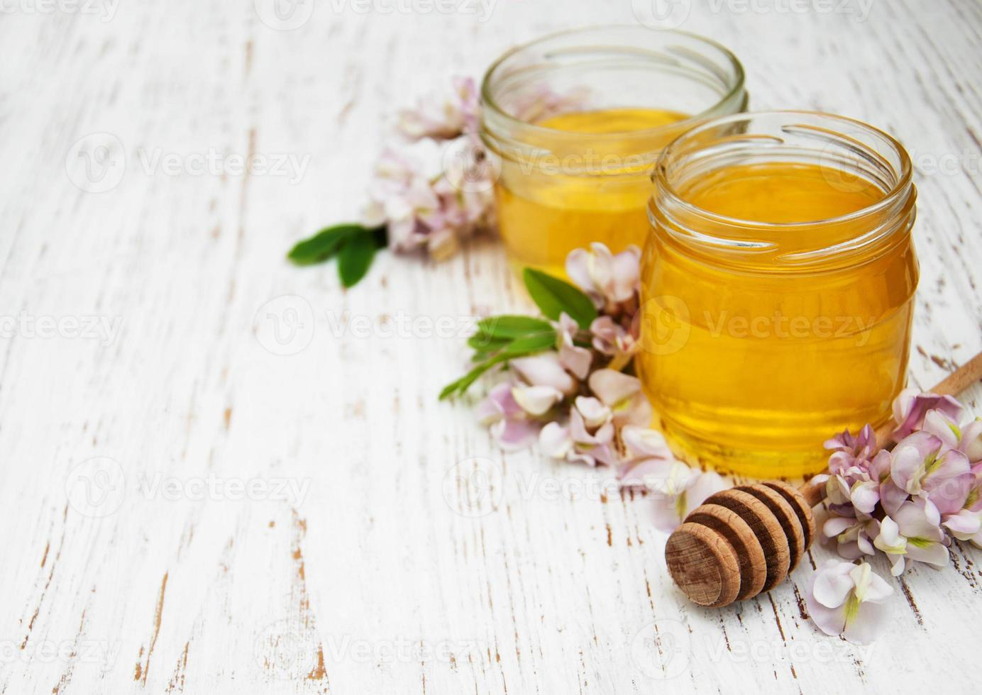 honey with acacia blossoms photo