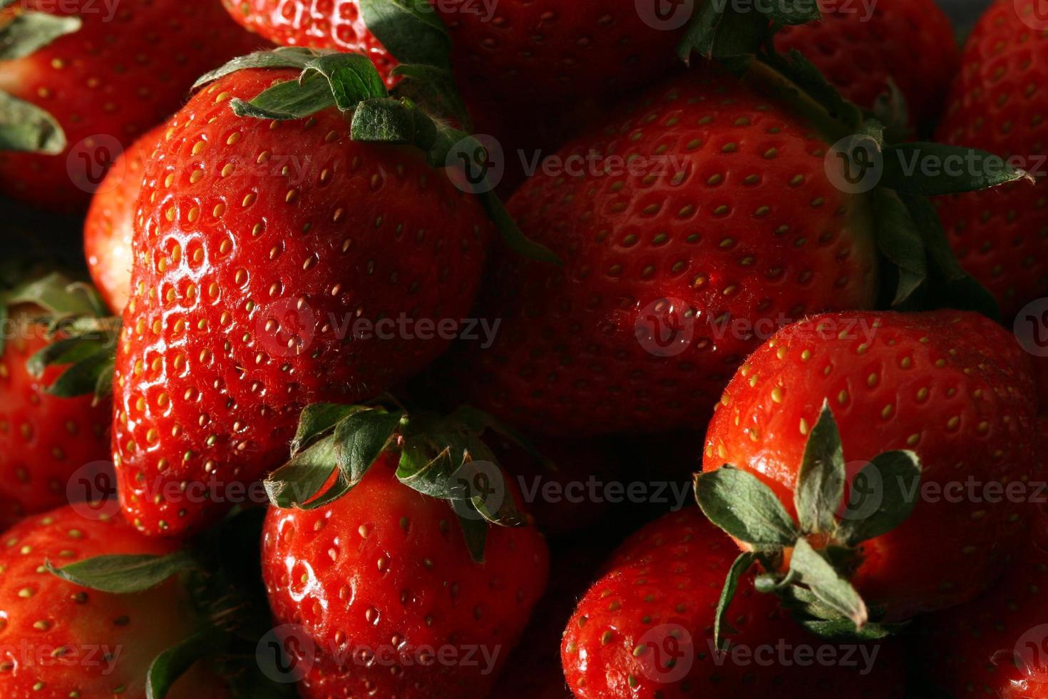 Fresh strawberries piled up photo