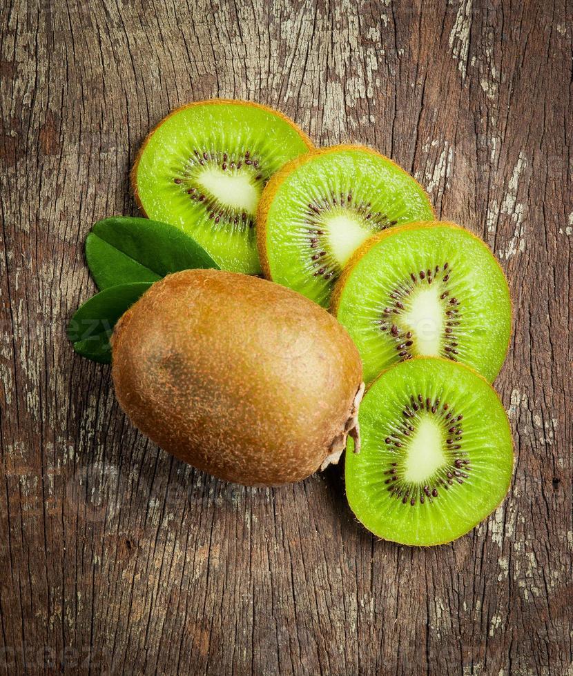 Fresh Whole kiwi fruit and his sliced half photo