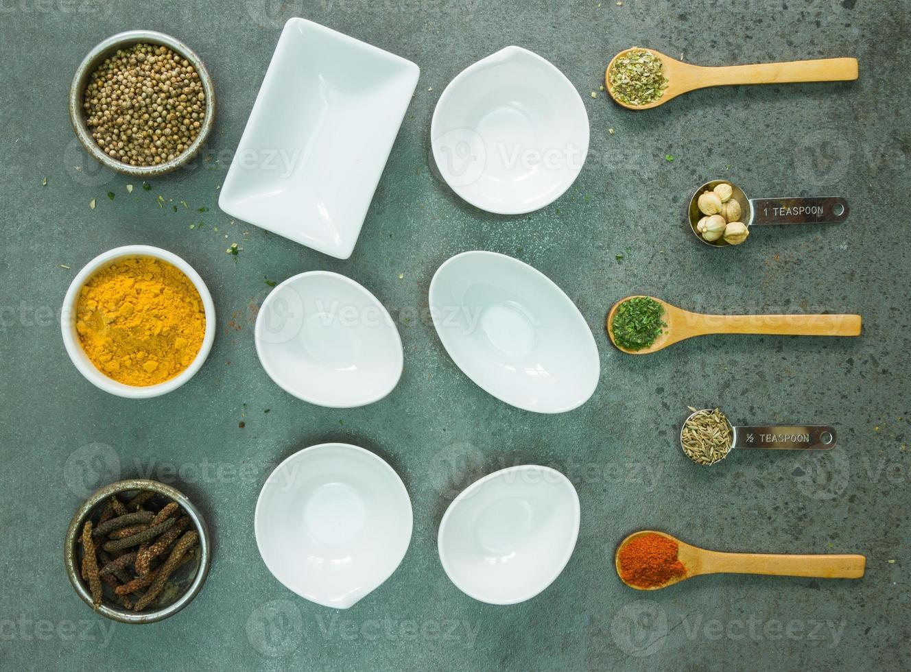 Spices and herbs in metal bowls. photo