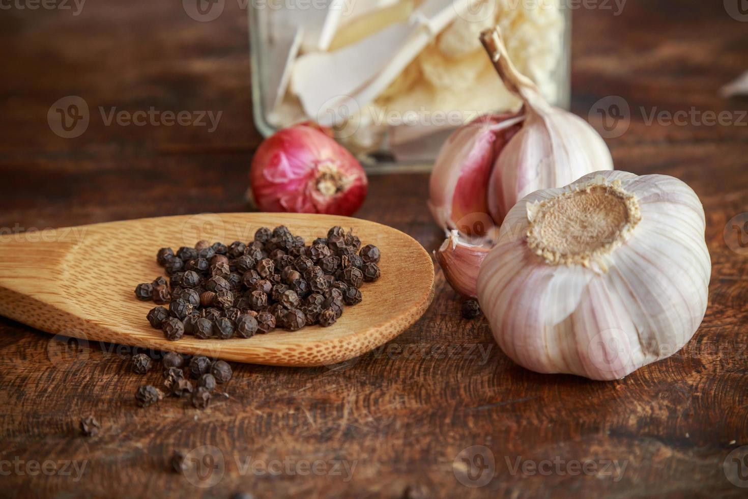 Garlic and onion organic herbs and spices on wooden background photo