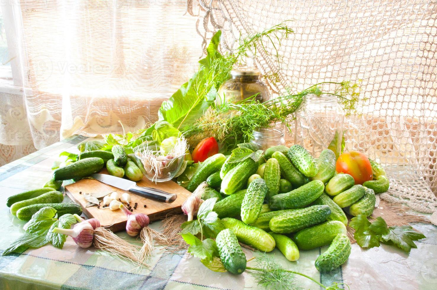 cucumbers on the table with spices photo