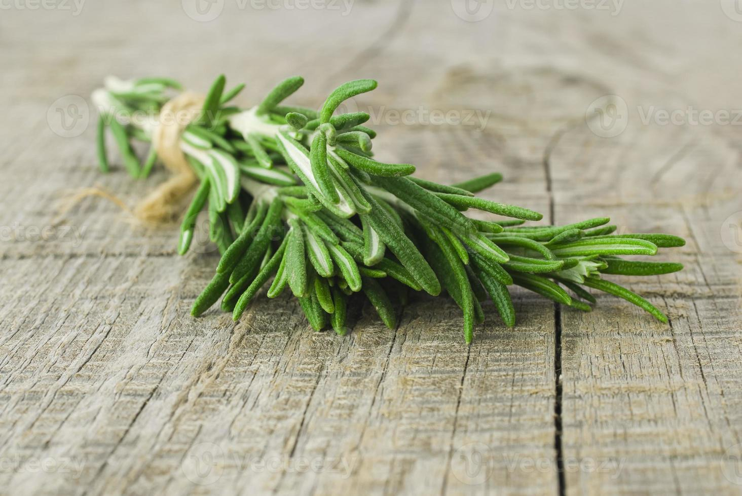 Rosemary bound on a wooden board photo
