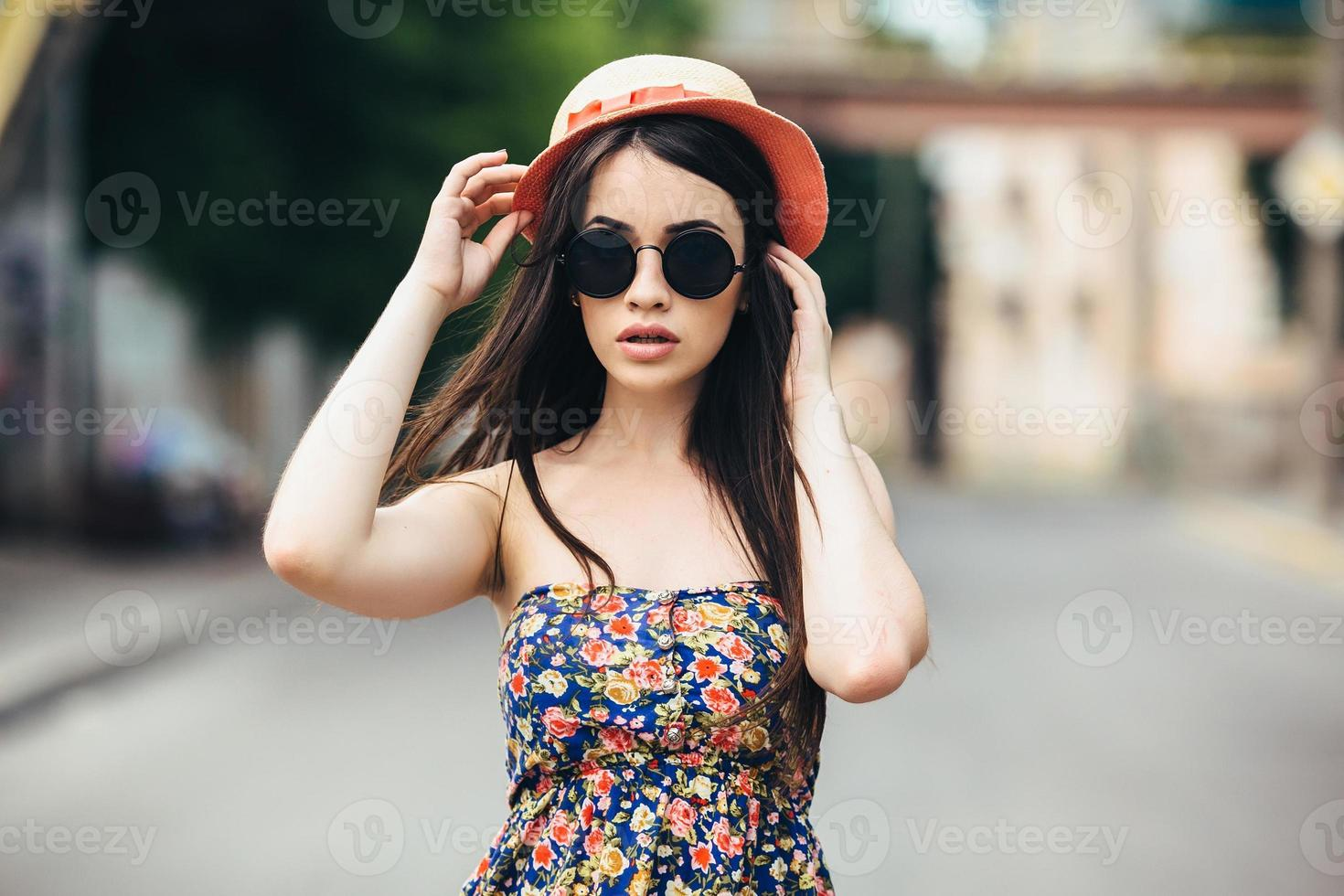 beautiful girl poses for camera in the city photo