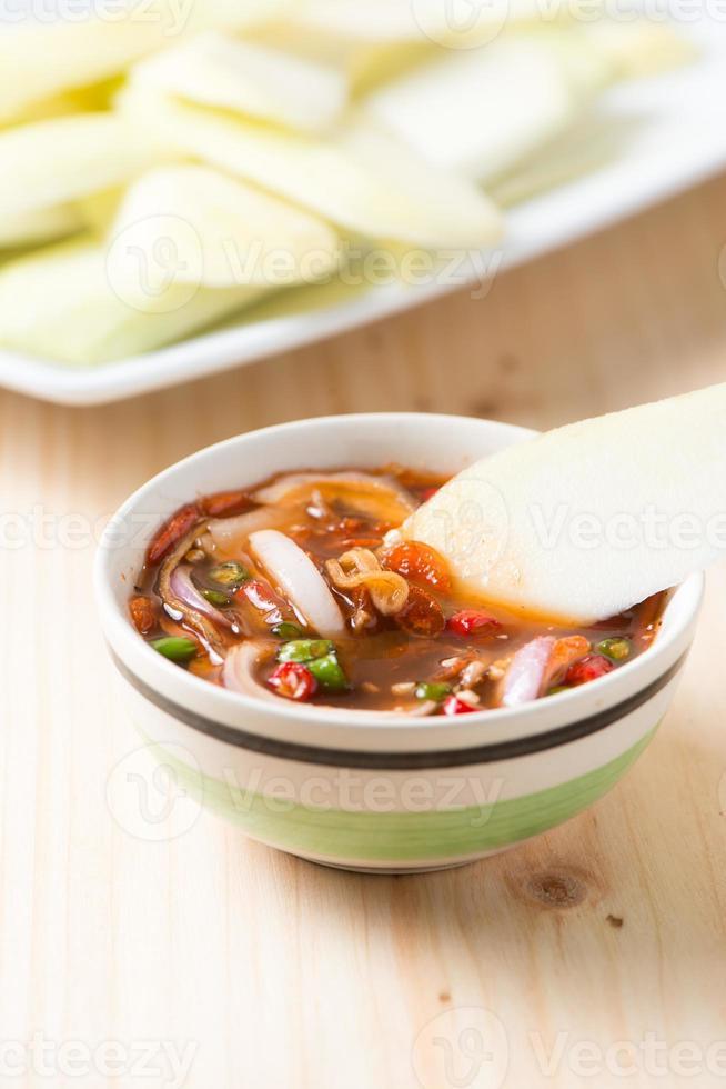 slice mango in sweet fish sauce photo