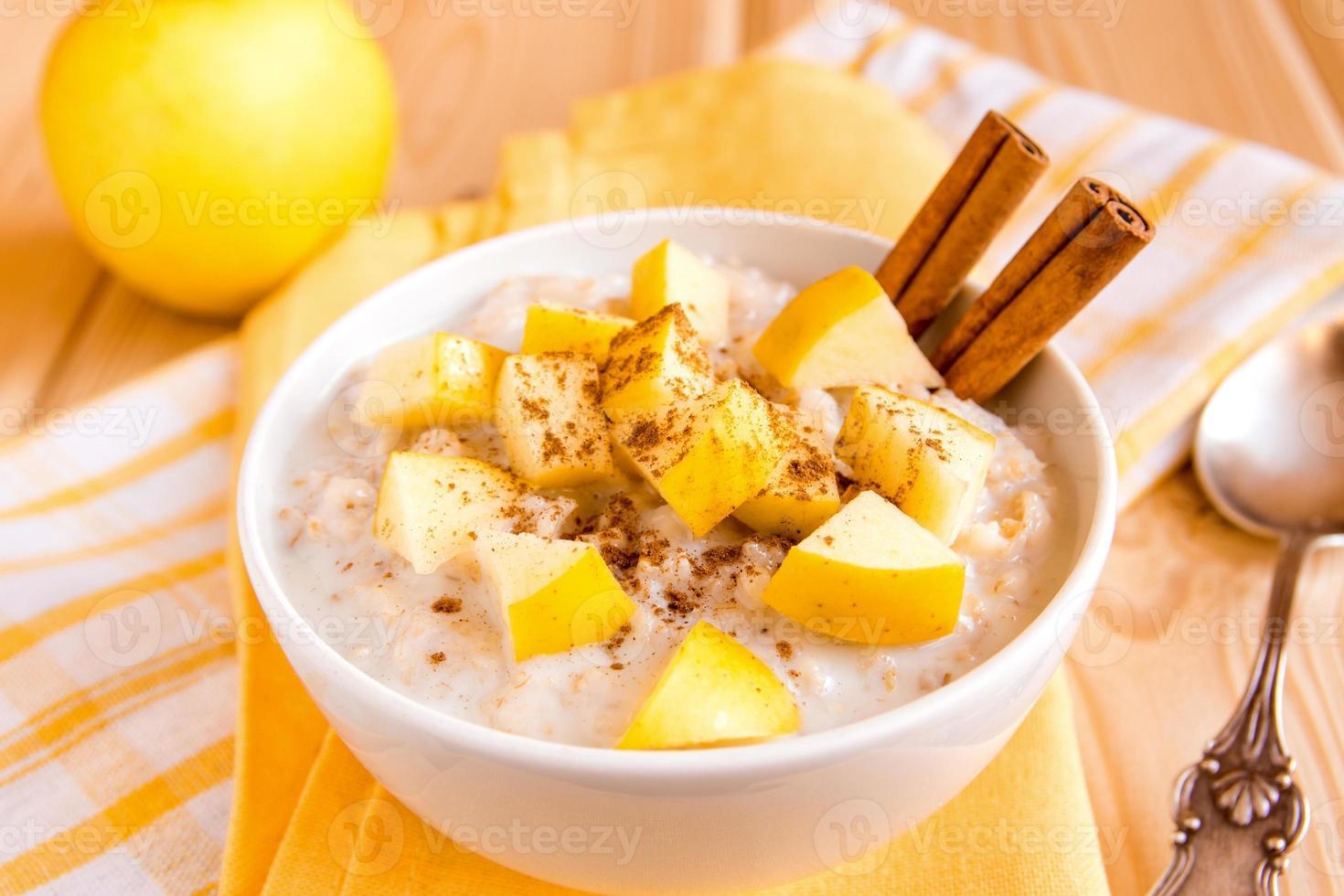 oatmeal porridge with apple and cinnamon photo